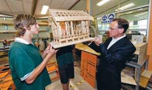Model students: Western Port Secondary College students Jake Parlberg and Cooper Wood with Greg Hunt. Picture: Yanni