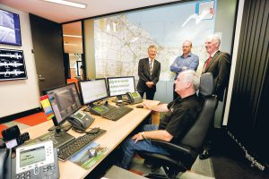 Checking the Peninsula Link control centre and one of its operators, above, are Linking Melbourne Authority chief executive Ken Mathers, left, Lend Lease general manager Philip Naulls and Nepean MP Martin Dixon (Picture: Yanni)