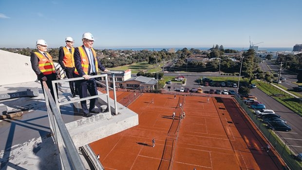 Holding high court: (from left) State Liberal MP Neale Burgess, State Liberal candidate for Frankston Simon Armistead and Health Minister David Davis look out over Frankston from a four-storey addition to Frankston Hospital. Picture: Yanni