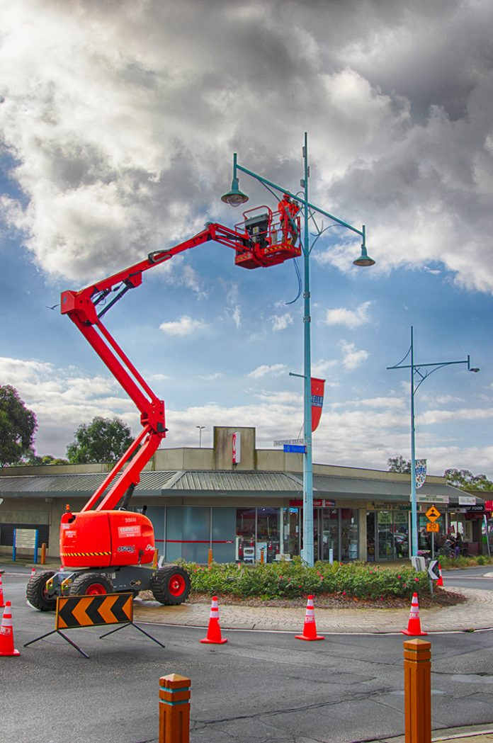 Pole work: Workmen use a cherry picker to install the long awaited CCTV cameras in High St, Hastings. Picture: Cameron McCullough