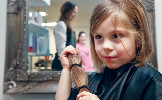 Getting wiggy with it: Jessica Bakionozos had her hair cut by Kellie Tredwell-Noonan of Dirty Little Secrets hairdressers in Hastings to make a wig for cancer sufferers. Picture: Yanni
