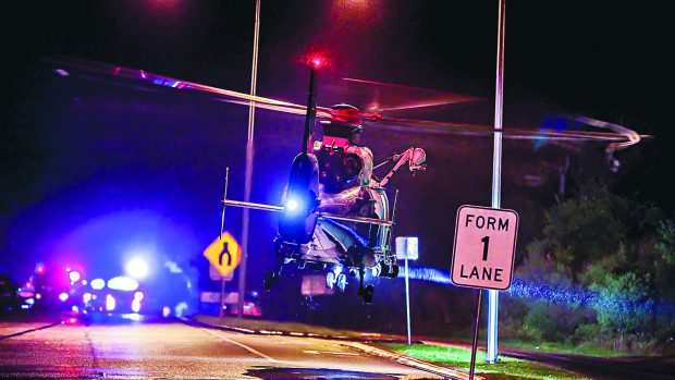 The airlift leaves the scene of the Western Port Highway crash. Picture: Gary Sissons