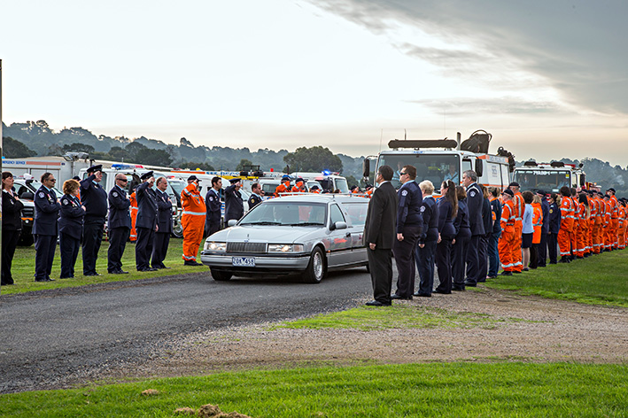 Fitting farewell: Dozens of SES and CFA personnel formed a guard of honour along the Peninsula Aero Club airstrip on 10 June to farewell devoted volunteer Peter Doutch, who died in an ultralight aircraft crash inTyabb.