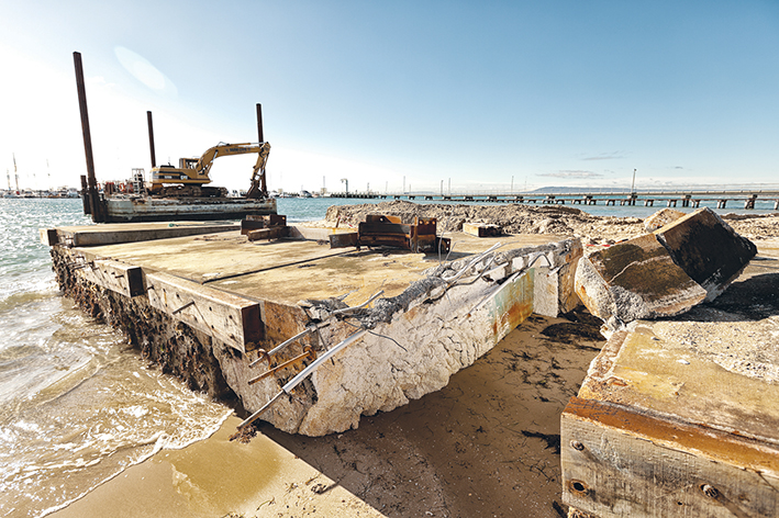 Breaking up: The broken concrete and polystyrene foam wave attenuator on the beach at Blairgowrie marina. Picture: Yanni