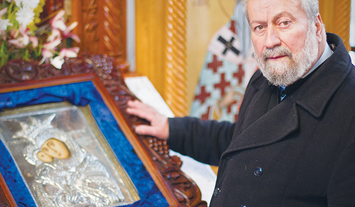 Devastated: The Reverend Father Eleftherios Tatsis with the Virgin Mary icon after the jewellery theft. Picture: Cameron McCullough