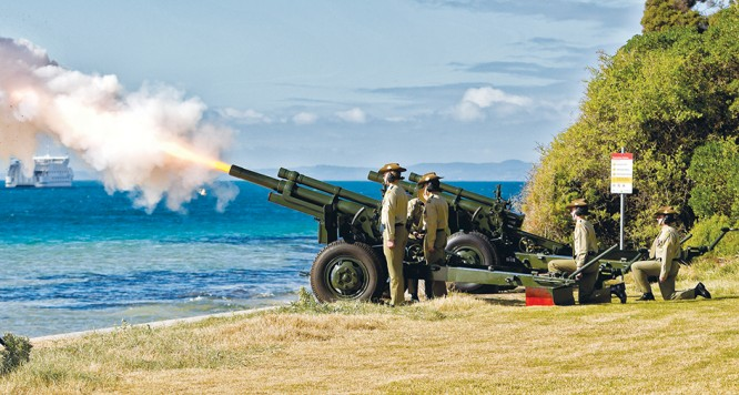 AN ear-shattering blast from a howitzer cannon perched at the tip of the Mornington Peninsula echoed across the waters of Port Phillip at exactly 12.45pm last Tuesday, marking the precise moment 100 years ago the first shot of the British Empire in the First World War was fired across the bow of a fleeing German merchant ship. Picture: Yanni