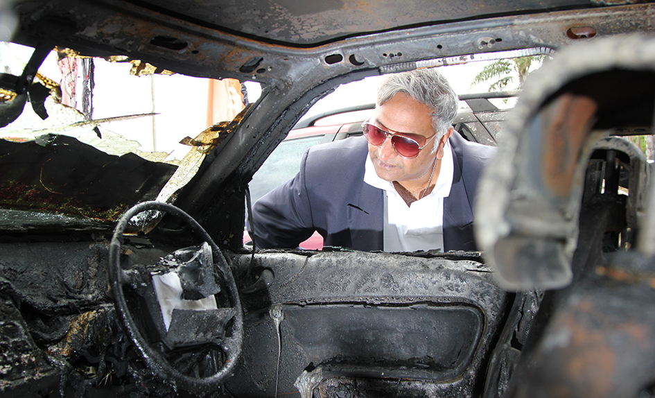 Burnt out: Longbeach Autos owner Gerry Marciny, above, inspects one of the cars  destroyed in Saturday's blaze. Picture: Cameron McCullough