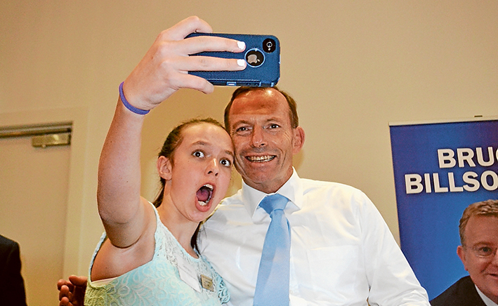 Last chance to see?: Mornington Peninsula Shire's Young Citizen of the Year Sarah Berry of Mt Eliza, left, took a selfie shot with Prime Minister Tony Abbott at Frankston RSL last Thursday.