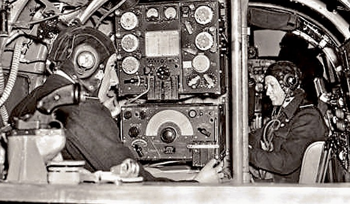 The wireless operator and navigator inside the Lancaster.