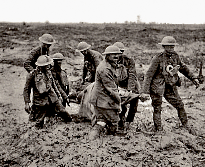 The mud made life difficult for everybody at Passchendaele. Stretcher bearers struggle through.
