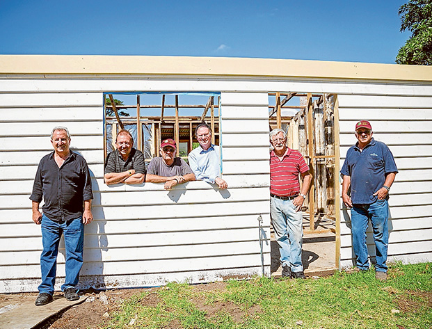 Good work: Community projects officer Ken Dyson, Cr Tim Rodgers, Wood Workers' Greg Millar, Cr Hugh Fraser, and Wood Workers' Dennis Conner and Gavin Davis, proudly show off their handicraft.