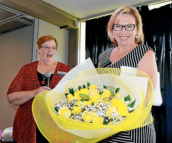 From the heart: Rosie Batty receives a bouquet of flowers by VIEW's national president Robin Perros.