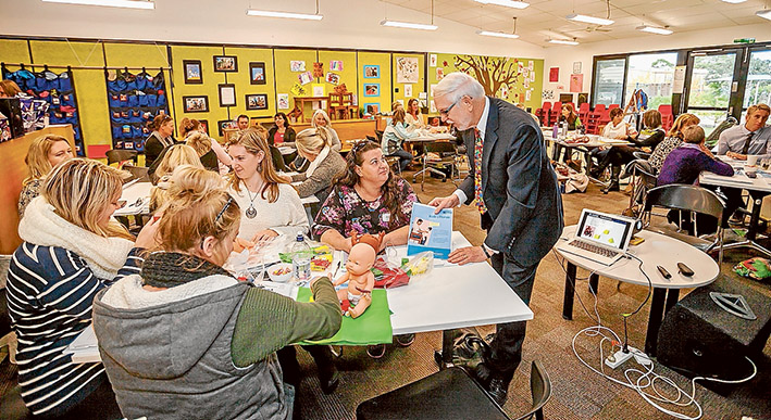 Language priority: Professor Joseph Sparling talks with parents and teachers at Seawinds Community Hub about his educational  program being adopted by Eastbourne Primary School. Picture: Yanni