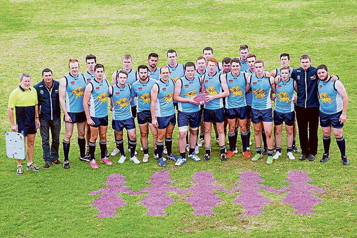 Message clear: The team shows off the Pink Lady stencils on the grass. Pictures: Defence.