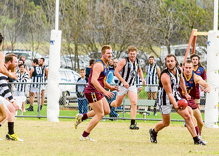 Milestone match: Luke Herrington, pictured with the pill, played his 150th game for Crib Point at the weekend. Picture: Barb Ross