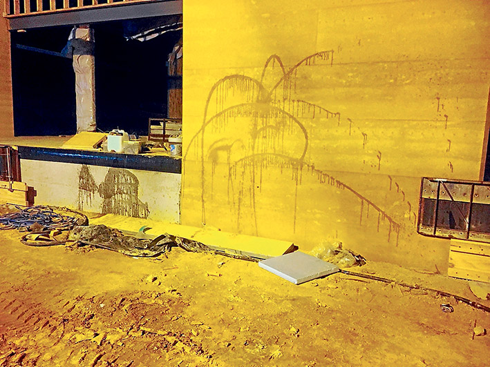 Vandalism spree: A police photograph of oil sprayed against the unfinished wall at the new Somerville Secondary College on Friday night.