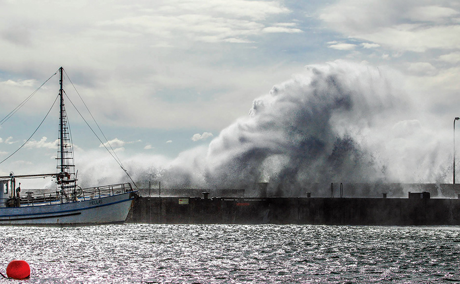 Pier awash: Waves crash over Mornington pier during strong winds on 6 May. Picture: Jai Just All Images