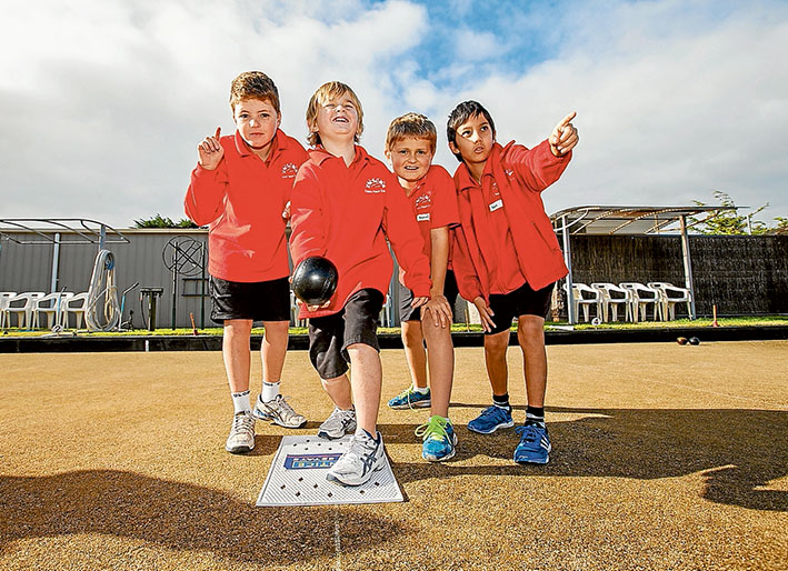 One up: Charlie, Josh, Daniel and Isao of Sorrento Primary School team which won the inaugural  Primary School Lawn Bowls Challenge. Picture: Yanni