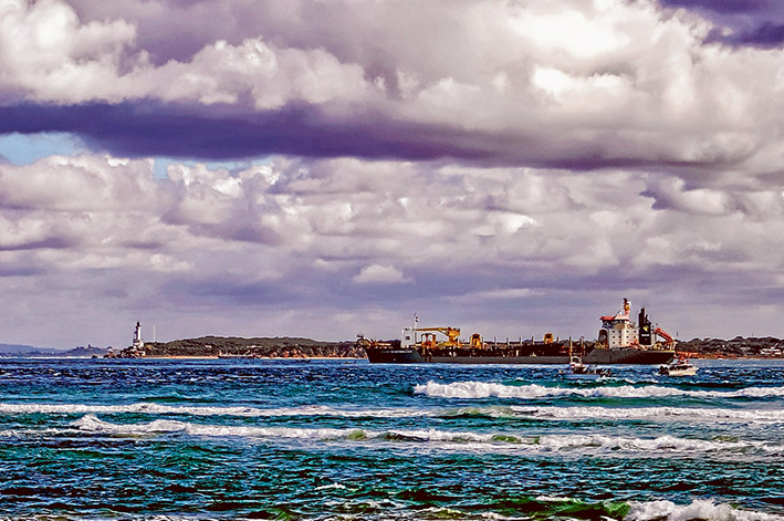 Flashback: It's 2008 and the Dutch dredger the Queen of the Netherlands works in The Heads to remove rock to allow ships of 14 metres draft to enter Port Phillip. Picture: Yanni