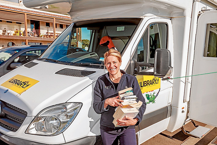Books not tourists: The shire has leased a campervan to replace the mobile library bus as it undergoes supersizing at a cost of $285,000. Librarian Veronica Wright at Mt Martha on Friday. Picture: Yanni