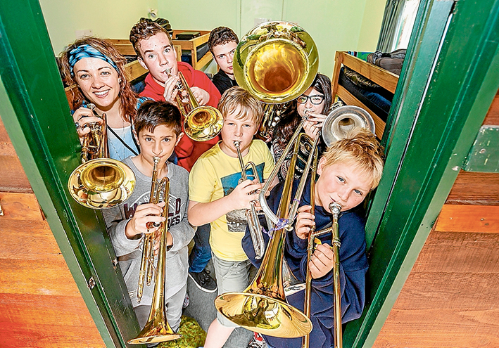 In tune: Tutors Natalie Parker, David Brackenrudge, Andrew Brunell and Stephanie Zavrou with students Max (Rosebud Primary) and Josh and Tommy (Pearcedale Primary) at the last week's Southern Peninsula Music Camp. Picture: Yanni