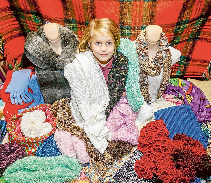 Good cause: The scarf stall makes a colourful and cosy backdrop for generous Isabelle Stanley. Picture: Yanni