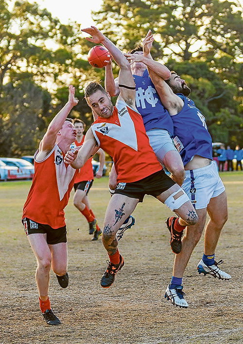 Hands up if you'd like the ball: Hastings dominated Red Hill to win by 32 points. Picture: Andrew Hurst