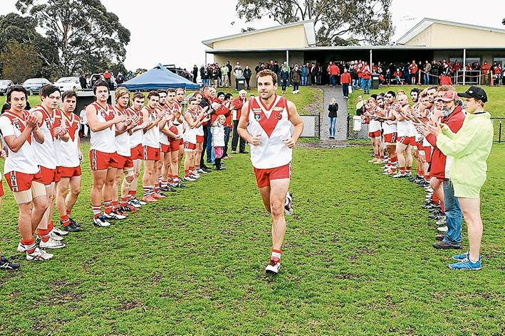 Guard of honour: Luke Van Raay runs out for his 250th game for his beloved Karingal Football Club. Picture: Andrew Hurst