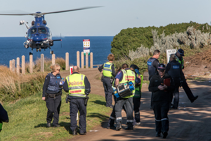 Fatal Crash Blowhole Flinders. I have been told it was a suicide but this was unconfirmed. The car looks like it hit the traffic island on blowhole track at speed, It became airborne and went over the cliff landing on the rocks below. Photo: Emergency services and the Police Air Wing survey the scene.