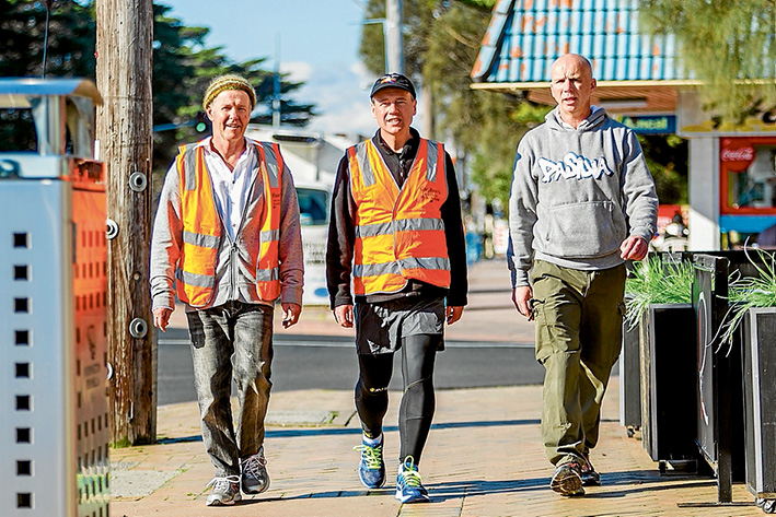 Respect: Australian Greens convener on the peninsula Malcolm Brown with federal Flinders MP Greg Hunt and Derek Fagan, of Statewide Autistic Services at Rye last Thursday, where the Greens donated to Mr Hunt's Walk for Autism fund. Picture: Yanni