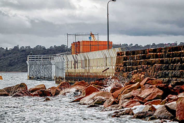 Three-parter: The three stages of the pier can be seen from the seaward side – the section built last century of bluestone, the middle section built in 2010-11 and the outer section started last year. The two new parts have 15-tonne concrete wave screens to protect the harbour. Picture: Yanni