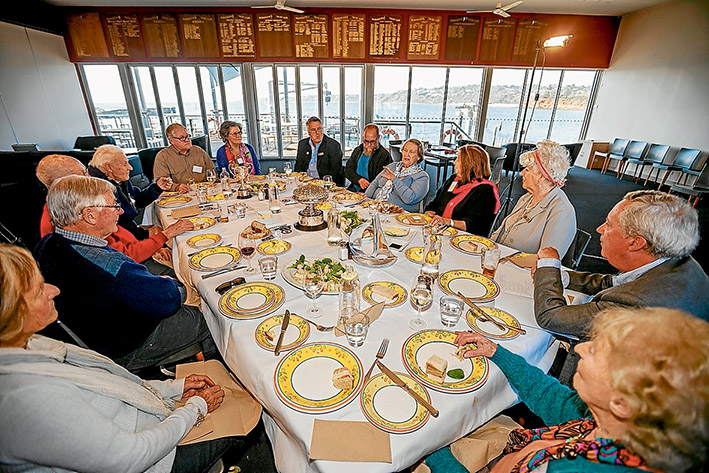 Memories sail back: Foundation member Joan Akland (blue/green cardigan), Alice Vaughan (blue jumper), member Kevin Willey (navy jacket) and Jack Bean (red Jumper) at the Mornington Yacht Club lunch. Picture: Yanni