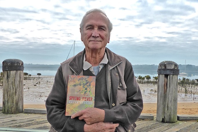 Write approach: Roger Stanley with his first novel Spring Fever. Picture: Fran Henke
