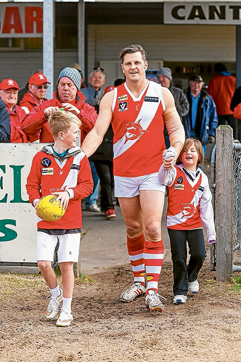 Family man: Guy Stringer comes onto the ground for his 400th game with son Archie and daughter Olivia by his side. Picture: Andrew Hurst