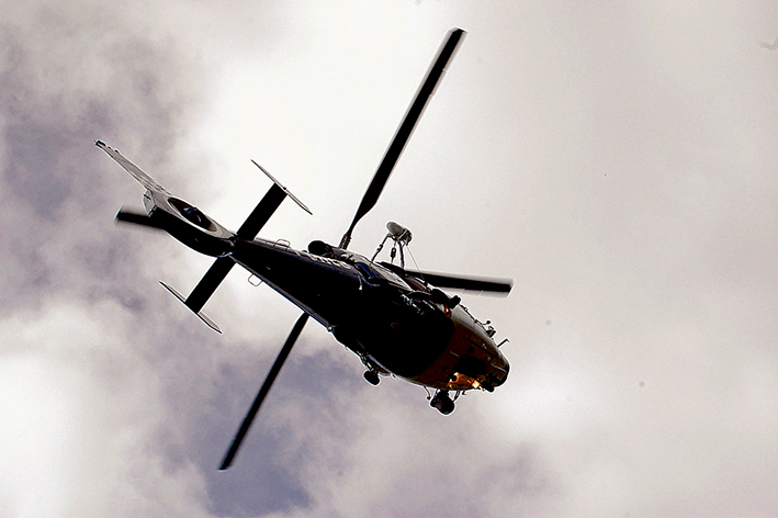Pad protest: Pen X was originally formed to fight proposals for five helicopter landing pads across the Mornington Peninsula but quickly morphed into a more wide-ranging activist group. The group was against the increased use of private and commercial helicopters, not those used by emergency services or the police, as pictured.