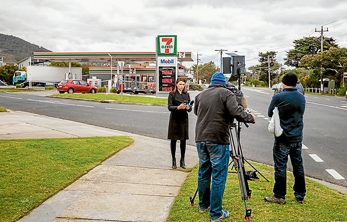 Newsmakers: Two violent armed robberies within 30 minutes were newsworthy enough to attract the attention of several television stations, including this crew from Channel 10. Picture: Yanni