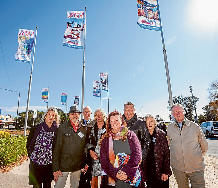 Flag raising: At the unfurling of the flag at Rye are, from left, Lynette Edwards, Michael Leeworthy, Peter Houghton, Sabra Lazarus, Jo Ridgeway,Miodrag Jankovic, Mechelle Cheers and Hugh Fraser.  Picture: Yanni