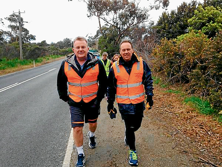 The at odds couple: Liberal cabinet colleagues Bruce Billson, left, and Greg Hunt, pictured on Mr Hunt's 500km sponsored Walk for Autism last month, favour different paths on the legalisation of same-sex marriage debate. Pic source Twitter