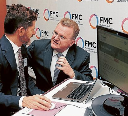 We can work it out: FMC executive manager Graeme Westaway, left, and Dunkley Liberal MP Bruce Billson at the launch of the financial first aid app in Frankston. Picture: Andrew Lloyd