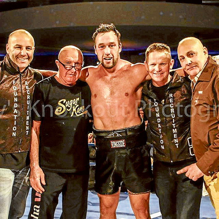 Title win: Bittern boxer Kane Watts in the ring after Friday night's win with Paul Gay, Ray Giles, Julian Holland and Brian Amatruda.