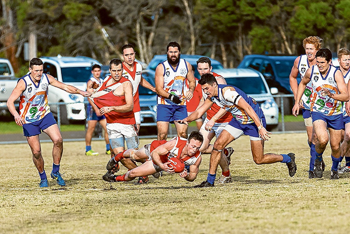 Four quarter effort: Red Hill got down and dirty to get up over Hastings and keep its Nepean League finals chances alive. Picture: Andrew Hurst