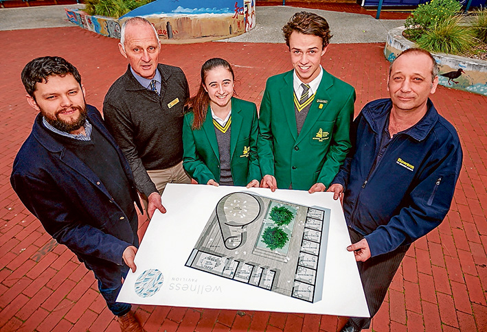 Plans at the ready: Holding plans for the Wellness Pavilion planned for Rosebud Secondary College are, from left, architect Nick Cini, assistant principal Geoff Seletto, school captains Alexandra Dellaportas and CooperCorbett, and George Stolz from Bowens. Picture: Yanni
