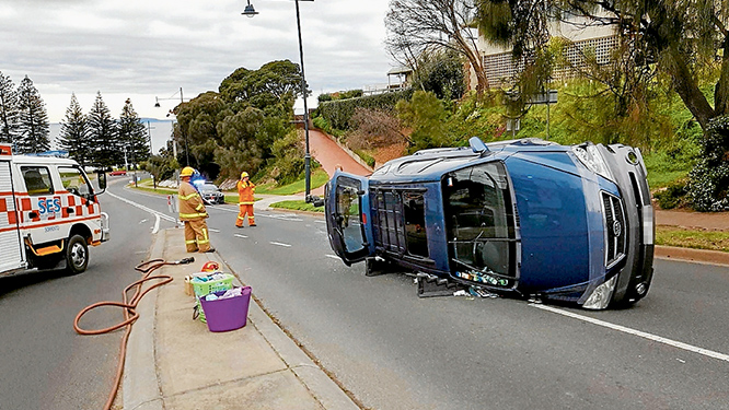 Flip side: Emergency crews freed a driver from this car which ended on its side in Ocean Beach Rd, Sorrento.                           Picture: David Lammers