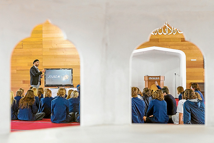 Faith talks: Padua College students James Beard and Saskia Kalkbrenner with Iman Syed Wadood Janud at the Bait-ul-Salam Mosque, Langwarrin.                    Picture: Gary Sissons