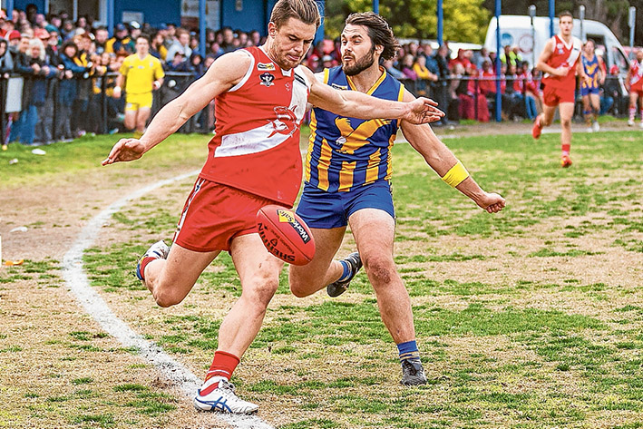 Pressure football: Somerville resisted a late charge from Sorrento to record a seven point victory. Picture: Andrew Hurst