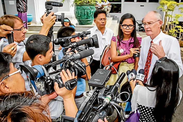 Making news: Alan Morison, right, and Chutima Sidasathian, centre, face the media during their trial in Thailand. They were cleared of criminal defamation charges last week. Picture supplied