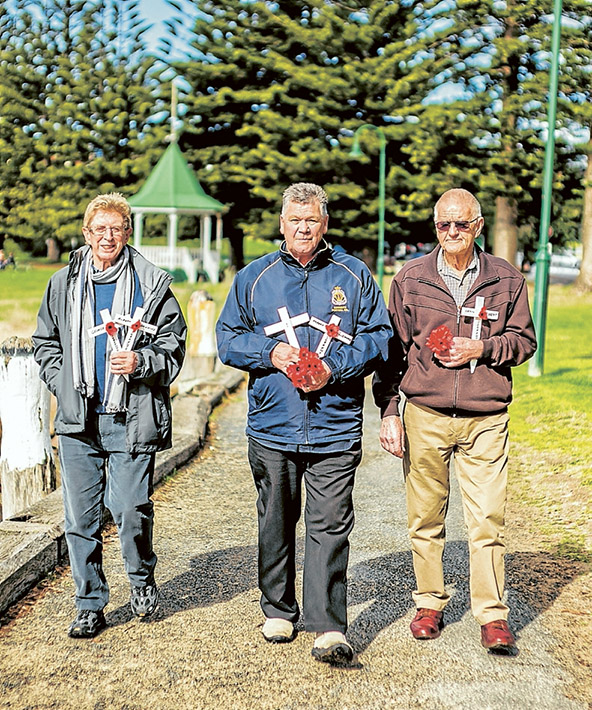 Lest we forget: John Phillingham, left, Michael Jeffreson and Peter Munro pay their respects to the war dead of Sorrento. Picture: Yanni