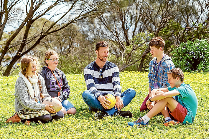 Nothing they can't do: Billie, Imogen, Ben and Caleb talk with former AFL player Jack Fitzpatrick. All are living with type 1 diabetes. Picture: Yanni