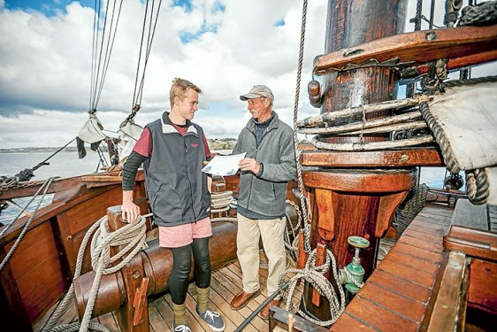Sailing mates: Enterprize captain Kevin Martin presents Nathaniel Grieef-Dickerson, of Mt Eliza, a year 10 student at Peninsula School, with a certificate of achievement.
