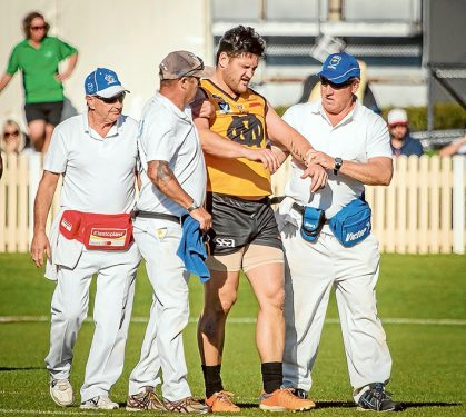 Groggy: Brendan Fevola after a big hit when he played for Ovens & Murray against a Peninsula League side earlier this year. Pic: Michael Kompa Photography